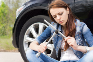 Girl fixing flat tire